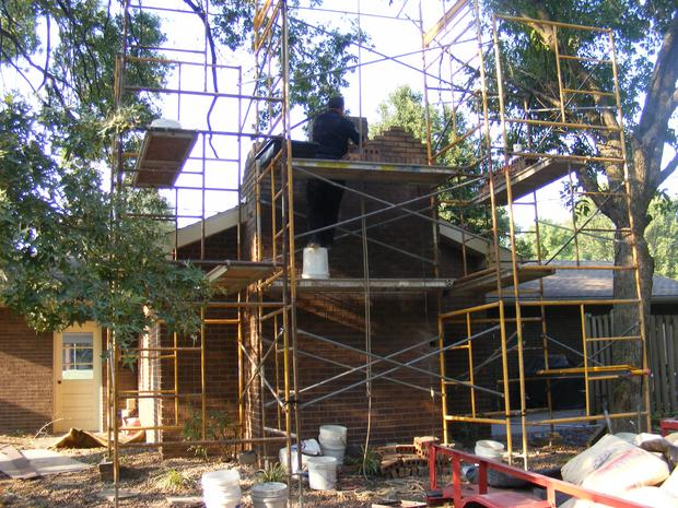 Building Brick chimney  with new Concrete crown Jasper Indiana.
