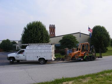 Hoosier Chimney Sweep,Inc. working at the CSIA school digging footers for new chimneys to be built for training purposes